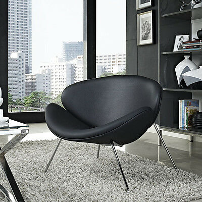Iconic Mid-Century Style Lounge Chair in Black Padded Vinyl Molded Cushions