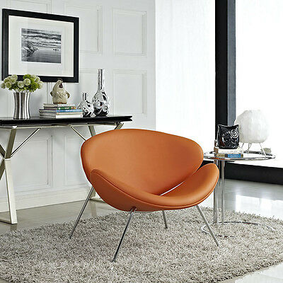 Iconic Mid-Century Style Lounge Chair in Orange Padded Vinyl Molded Cushions