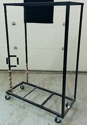 Wheeled rack for folding chair