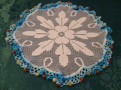 Vintage Glass  Beaded Jug Cover With Varigated Blue Coloured Crocheted Edge