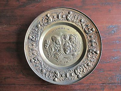 Antique ornate brass look tin wall plate depicting medieval dentistry dentist