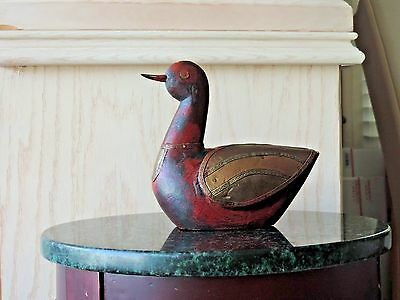 Carverd wooden loon brass fitted wings, breast plate and eyes. India