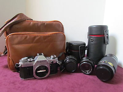 Canon AE-1 35mm Camera with 3 Lenses, Camera bag and manuals