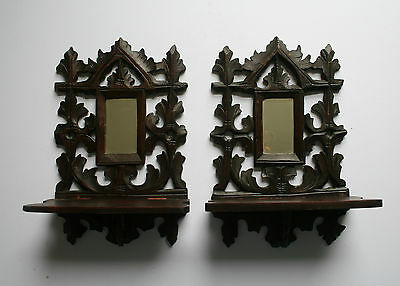 Pair of antique Black Forest carved wood candle sconces bevelled mirror gothic