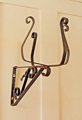 Black cast iron Victorian plant holder wall hanger vintage metal wall mount