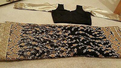 Brand new heavy worked net black and gold saree