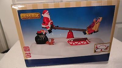 Christmas Village Animated Santa On A Sew-Saw With 2 Children,it Goes Up & Down