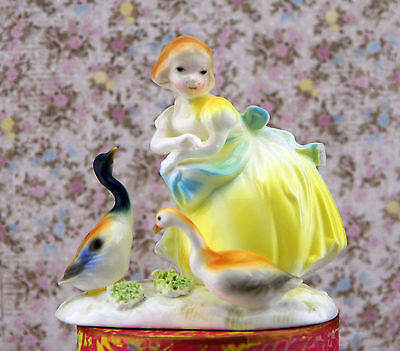 Sweet figurine of a girl and two geese, made in Japan.
