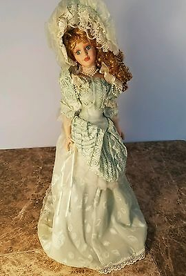 "Victorian Porcelain Doll 21.5"" With Stand Unmarked but stamped"