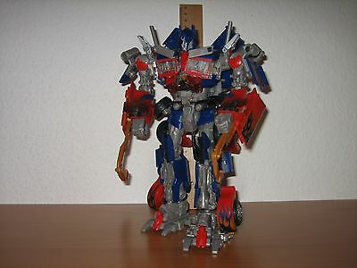 Transformers Figur - HFTD Optimus Prime Leader - BATTLE HOOKS - Licht & Sound