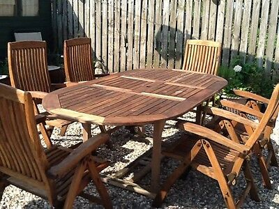 teak garden table and 6 reclining chairs