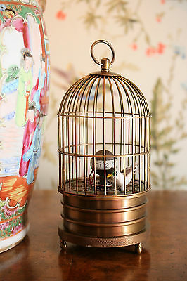 Charming Bird in Cage Clock Automata
