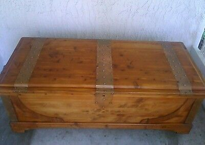 Vintage Cedar Hope Chest Trunk With Copper Accents On Wooden Caster Wheels