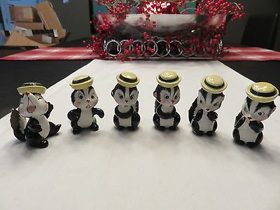 Japan Skunk 6 Figurines with matching Yellow Caps! super cute!