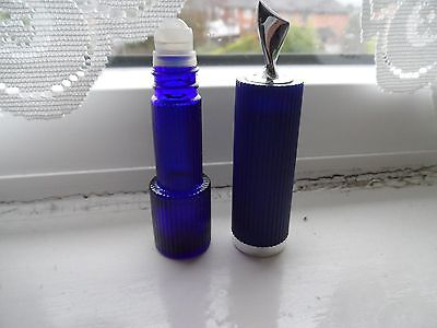 avon roll on perfume plastic  and glass blue roll on moonwind empty kitch