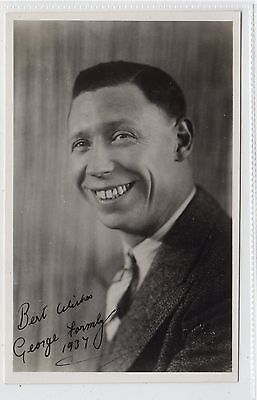 Signed picture postcard of George Formby (C24427)