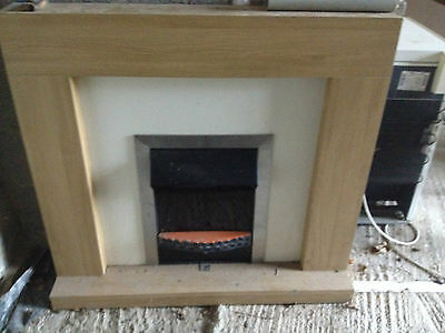 Electric fire with surround, lounge, mantle, heater