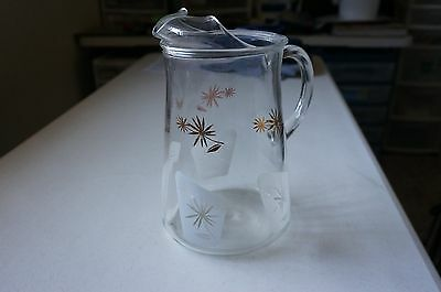 """Vintage heavy glass Pitcher with Gold and White flower design 9"""" tall"""