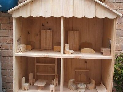 Wooden Dollhouse including all wooden furniture ( 20 pieces ).