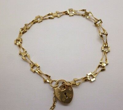9ct yellow gold gate bracelet with love heart padlock clasp and safety chain