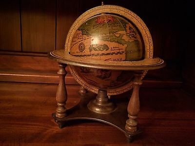 Decorative desk top revolving old world globe in stand