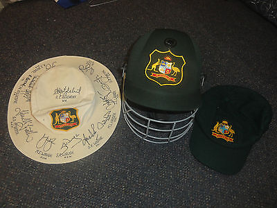 player issued signed australia cricket test floppy plus baggy and helmet