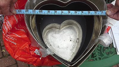 Set of 4 heart shaped cake cooking tins .