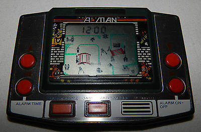 **ultra Rare Vintage A-Man Lcd Electronic Handheld Game &/and Watch Style**