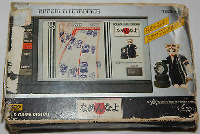 VINTAGE NAMEN NAYO LCD HANDHELD BANDAI GAME IN BOX/BOXED/CATS/CARS/highway/watch