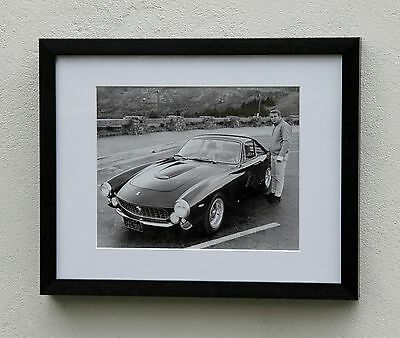 A framed and mounted photograph Steve McQueen and his 1963 Ferrari 250GT Lusso