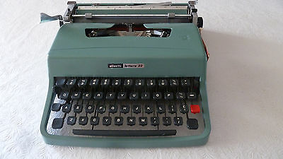 Vintage Olivetti Lettera 32 portable typewriter, case and instructions.
