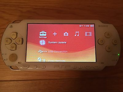 White Sony PSP Console & Games. Incl; Patapon, WipEout Pure, Locoroco 1 & 2 UMDs