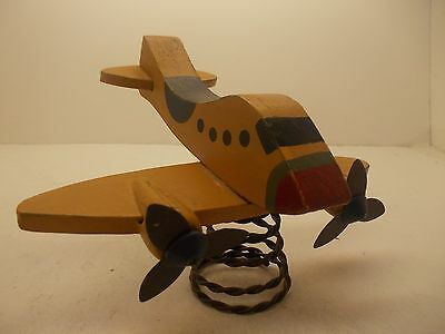 vintage,wooden,handmade,and painted airplane
