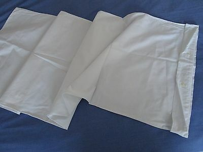 Vintage white cotton bolster case with button fastener.