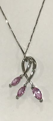 9ct white gold pink sapphire set pendant with 18inch box chain.