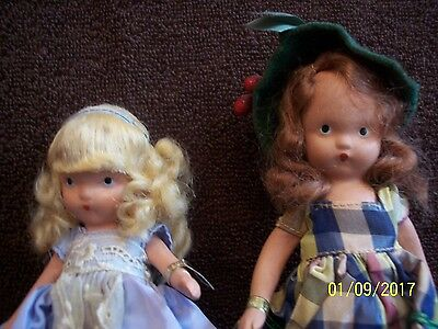 2 bisque Nancy Ann dolls with wrist tags #111 and#125