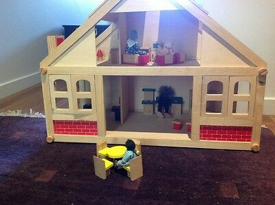 Beautiful wooden dollhouse set with people and furniture