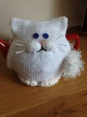 Hand-knitted Snowy the white cat tea cosy. Fits medium to large teapot