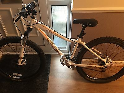 Lady's Orange Mountain Bike