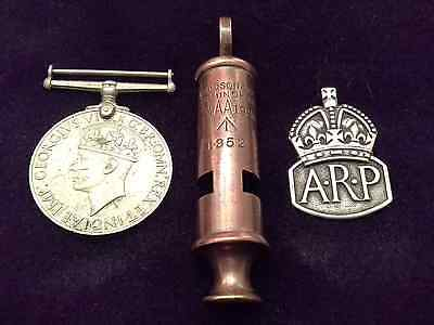ww2 medal, silver arp  badge and 1952 military whistle