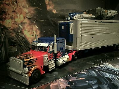 Transformers - Optimus Prime DOTM Ultimate Mechtech - Mit Licht & Sound