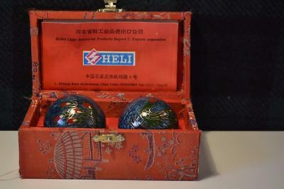 Collectors Chinese Enamelled Musical stress Stress Balls.