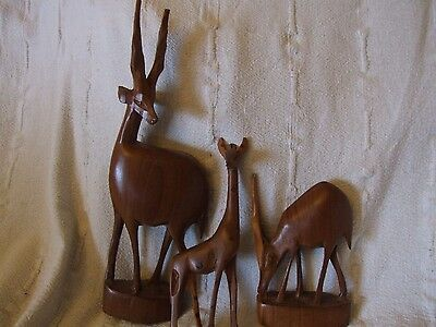 three wood animals figures hand  carved from kenya