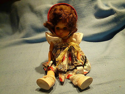 Vintage Small 7.5 Inches Hard Plastic Doll In Original Outfit