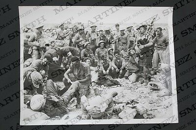 WWII Official Press Photo: Highland Regiment Piper Entertaining British Wounded