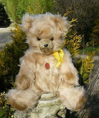 GERMAN VINTAGE MUSICAL BEAR WITH TAGS MINT CONDITION - Plays 'Raindrops'
