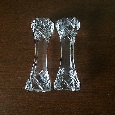 A pair of decorative vintage glass hexagonal knife rests