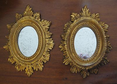 Pair of Small Hand Carved Gilt Wood Sunburst Mirrors with Spotted Glass