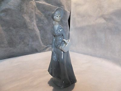 Porcelain Lady Figurine With Basket.