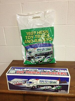 Mint Cond.  New In Box 1997 HESS Collectible Truck With Two Race Cars With Bag